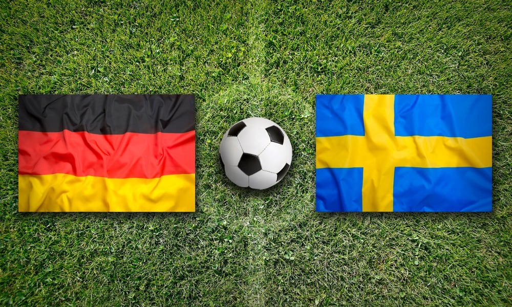 germany vs sweden flags on soccer field picture id648600344